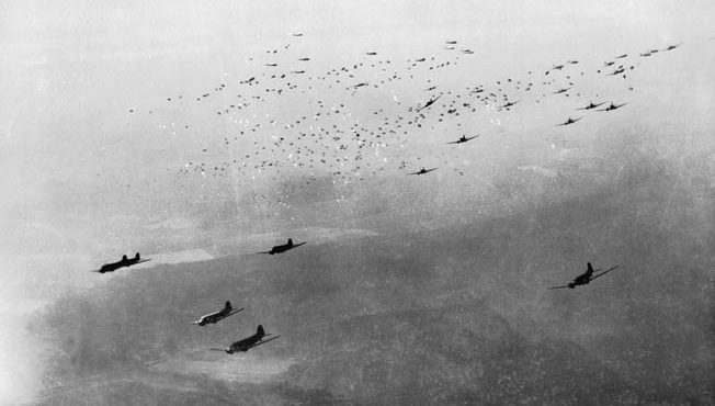 C-47 Skytrain and C-46 Commando transport planes drop 17th Airborne paratroopers north of Wesel, Germany, March 24, 1945. Some 40,000 paratroopers and 1,500 troop-carrying planes and gliders took part.