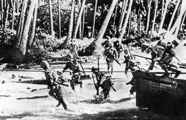 Japanese troops swiftly exit their landing barges and cross an invasion beach on Java. Resistance was relatively light, and the invaders rolled forward, suffering few casualties in the opening hours of their offensive to conquer the island.