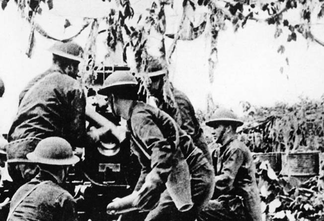 Soldiers of an American artillery unit take up defensive positions on the Bataan Peninsula during the defense of the Philippines against Japanese invaders in the spring of 1942.
