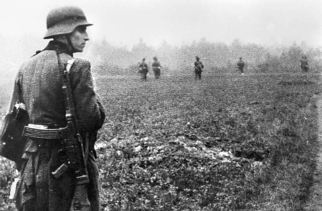 German infantry patrol a Dutch field in search of Allied airborne and glider troops. The soldier in the foreground is armed with a Sturmgewehr 44.