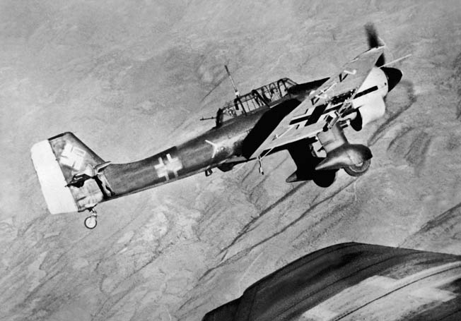 A Junkers Ju-87 Stuka dive bomber of the Luftwaffe wings over as its pilot acquires a target while flying above embattled Yugoslavia.