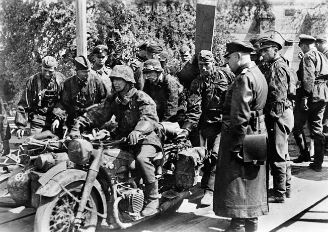 Riding motorcycles, soldiers of the German SS Division Das Reich pause during the assault on Belgrade. A small motorized detachment of Das Reich led by Captain Fritz Klingenberg captured Belgrade in an audacious and brilliantly executed advance.