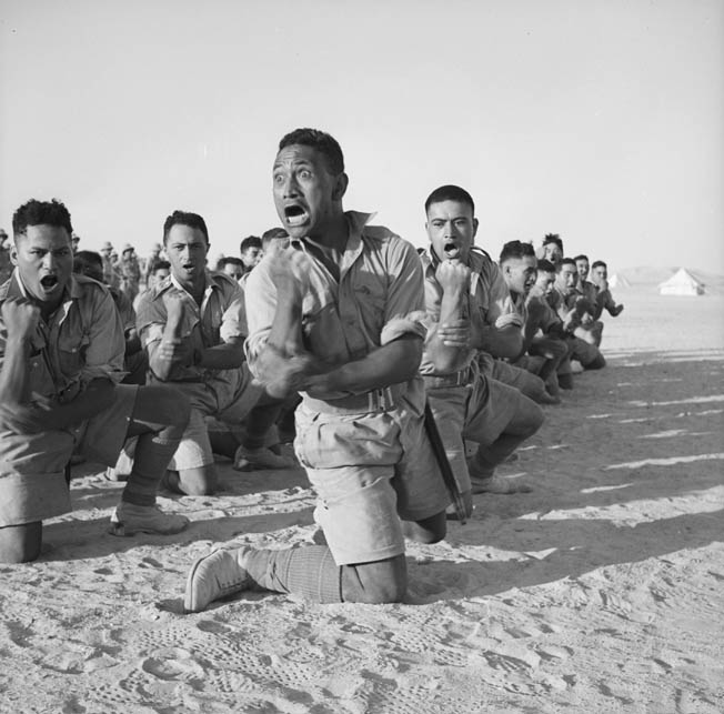 "Maori troops from New Zealand perform the ""Haka,"" a fearsome dance performed before battle to instill courage and fight into the dancing warriors and terror into any of the enemy who might observe it."