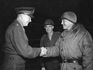 Eisenhower, left, confers with Bradley, center, and Patton,