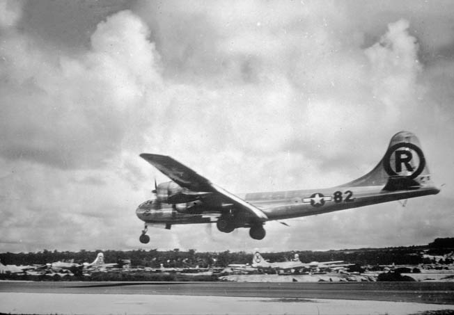 "Pilot Paul Tibbetts's B-29 Enola Gay returns to Tinian after dropping ""Little Boy"" on Hiroshima."