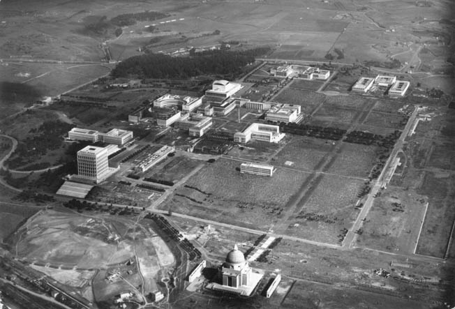 Aerial view of the partially completed site. The dome of the Basilica of Saints Peter and Paul is at the bottom, center, while the Armed Forces complex (today home of the Central State Archives) is at upper right.