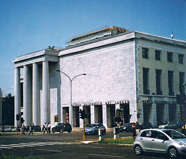 """Today EUR, with its evocative echoes of its fascist past, is a bustling commercial and residential suburb of Rome. This architecturally """"clean"""" building is a bank."""