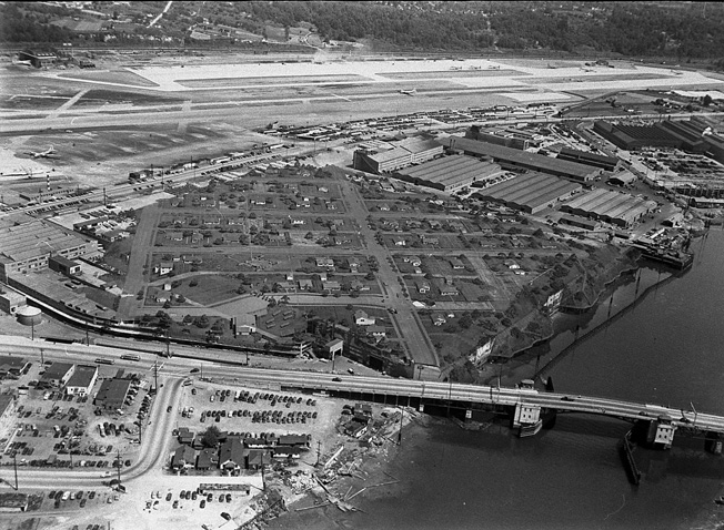"A view of Boeing's Plant 2, looking toward the southeast, clearly shows Wonderland's ""street grid."" The presence of B-29 Superfortresses on the ramp and runway indicate that this photo was taken late in the war."