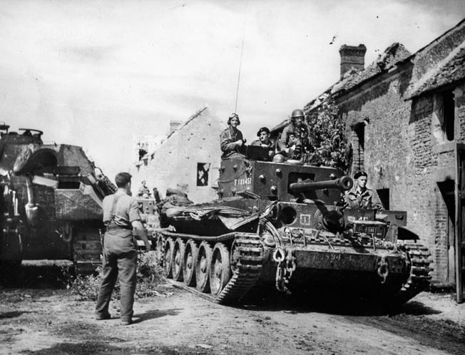 A 1st Polish Armoured Division Cromwell tank rolls through a French village on the way to Mount Ormel, where the Poles would make a courageous defensive stand.