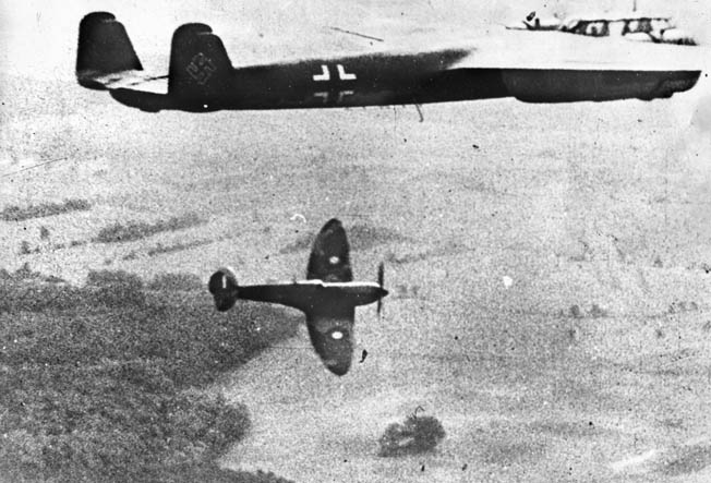 "A Spitfire ""Supermarine"" takes on a German Dornier Do-17 in the skies over England, December 1940. With the RAF getting most of the credit for preventing a German invasion, the role of the Royal Navy has been overlooked."