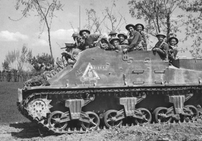 "Men of the 2nd Battalion, London Irish Rifles, part of the 38th Irish Infantry Brigade, ride into battle in Italy in a ""Kangaroo""—essentially a tank that British and Commonwealth units converted from a gun platform to an armored personnel carrier."