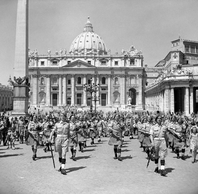 After a special audience with Pope Pius XII, attended by both Catholic and Protestant soldiers, the Irish Brigade band parades smartly in front of St Peter's Basilica in Vatican City, June 12, 1944.