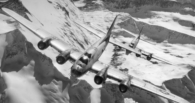 Two B-17 bombers fly over the snow-capped Italian Alps. Fitzpatrick's bomber once had to cross the Alps on only two engines.