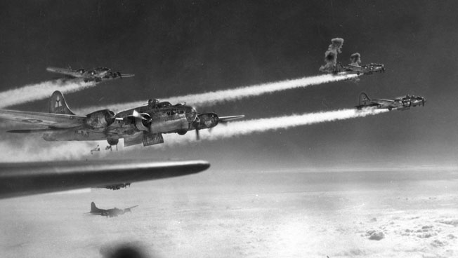 With flak bursts exploding in their midst, B-17 bombers of the 69th Bomb Squadron head to their targets over Austria. Fitzpatrick narrowly escaped death when two chunks of flack shot through his bomber's fuselage, almost hitting him.