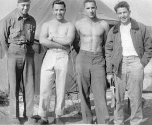 Six days before Germany surrendered on May 8, 1945, Fitzpatrick, second from left, beat the summer heat by going shirtless at Amendola Airfield in Italy. On the ground, bomber crews dressed informally but donned their uniforms for missions.