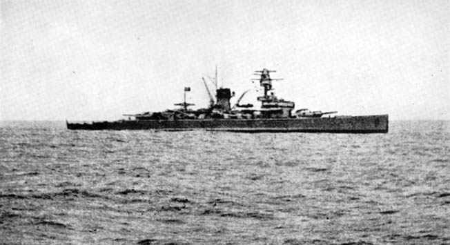 Photographed by a crewman aboard the City of Flint, the powerful German pocket battleship Deutschland is shown in this photo. Mounting 11-inch guns, the German raider was a major threat to Allied shipping.