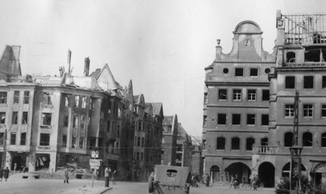 After crossing the Rhine River on March 27 near Duisburg, my father accompanied the battalion's reconnaissance company along the east side of the river for a brief trip south to Dusseldorf and Cologne. This photo shows some of the destruction in Dusseldorf.