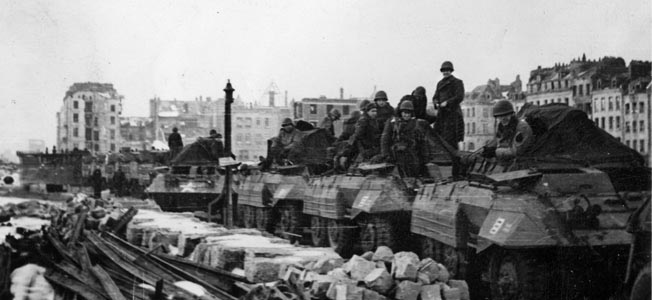 The 809th Tank Destroyer Battalion prepares to move out from the French port of Le Havre on January 22, 1945. The equipment consists of M20 command and reconnaissance cars belonging to the 809th's A Company. The M20 was a variant of the M8 Greyhound, with the turret and 37mm cannon removed.