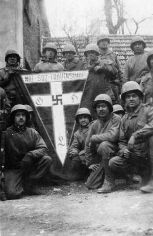 Members of the reconnaissance company (attached to  battalion headquarters) pose with a souvenir banner of the National Socialist Women's League, an organization that collected scrap metal, provided refreshments to German troops at railroad stations, and disseminated Nazi propaganda materials to women.