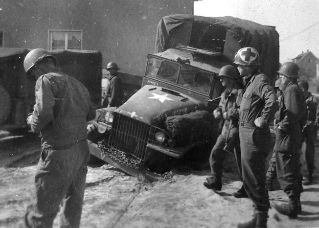 The effects of what the Russians call rasputitsa (sea of mud) that occurs due to spring snowmelt. Here a kitchen truck belonging to the reconnaissance company attached to battalion headquarters is stuck in hardened mud. (Photo taken April 21, 1945, in Halberstadt, Germany.)