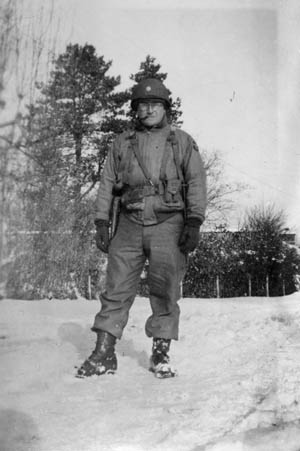 My father, Major Louis R. Fausset, photographed on February 3, 1945 (his 26th birthday), near Maucomble, France. The battalion was en route to the front lines in Holland and bivouacked for 10 days in Maucomble (approximately 75 miles northeast of Le Havre, in upper Normandy). The battalion's first combat action would occur on February 20 near the town of Berkelaar, Holland.