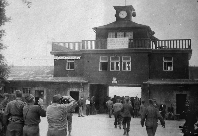 After the Allies began uncovering concentration camps, General Eisenhower directed that as many units as possible visit Buchenwald, outside of Weimar, to bear witness to Nazi atrocities. My father and other officers visited the camp in late May or early June of 1945. Here the visitors are snapping photos of Buchenwald's main gate.