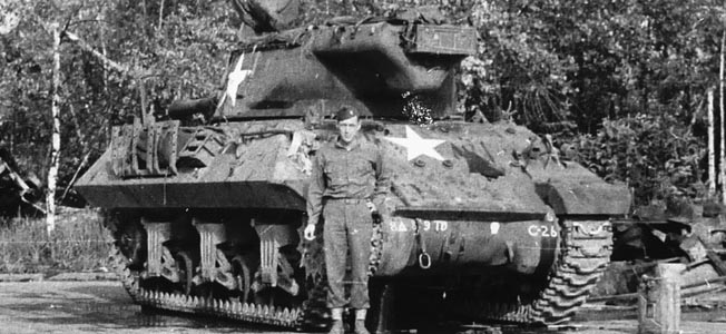 An unidentified 809th TD Battalion officer poses in front of an M36 Jackson tank destroyer. The battalion operated with M18 Hellcat tank destroyers from the beginning of their deployment until April 11, 1945 (Baker Company) and April 13, 1945 (Able and Charlie Companies), when they were replaced with M36 tank destroyers in Soest, Germany.