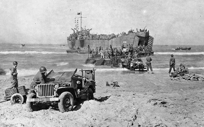 Vehicles land in Sicily. Although the fighting had already moved inland when Craig landed at Gela Beach, enemy artillery salvos still exploded around his tank.