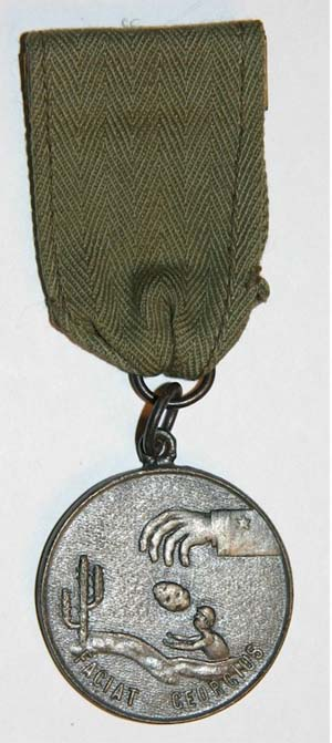 """Twining's group had decided that the obverse side of the medal should have an outstretched hand with Navy stripes on the lower sleeve, dropping a hot potato in the shape of Guadalcanal into the hands of a tired, less than grateful Marine. They also discussed the idea of depicting a transport ship with a stern on each end so that it could """"haul ass without turning around."""""""