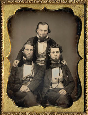Photographer Cook, center, poses with unidentified friends in 1862.