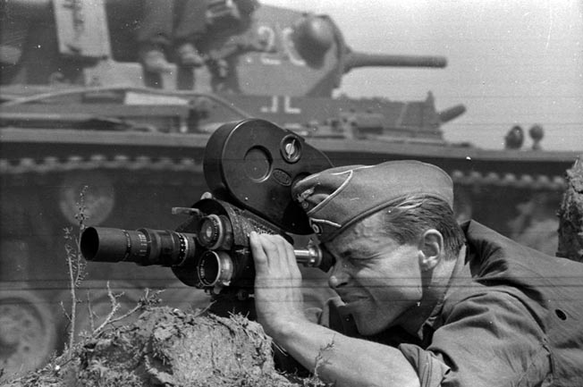 A German newsreel cameraman focuses on an armored column moving into the Soviet Union. Like their American and British counterparts, German cameramen superbly documented the war.