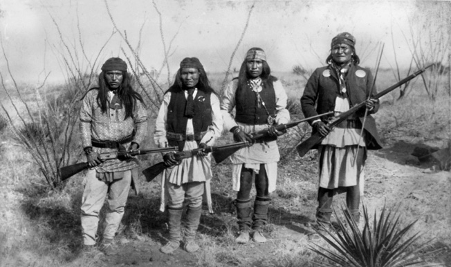 Geronimo (far right) and some of his relatives in 1886. White settlement and mining on their native lands sparked hostilities between the Chiricahua Apaches and the U.S. Army.