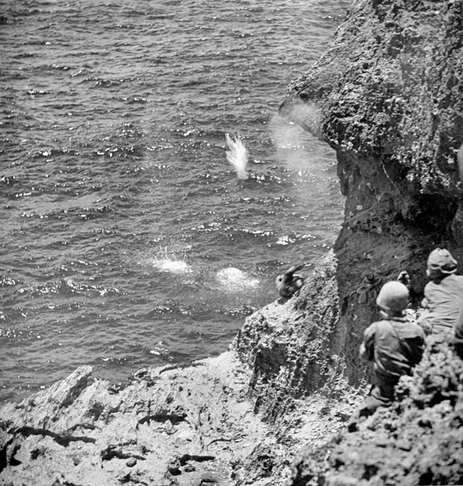 Believing horrific tales of American atrocities fabricated by Japanese military propagandists, Japanese civilians commit suicide by flinging themselves and their children from the cliffs at Marpi Point on the island of Saipan. Unable to intervene, U.S. Marines watch helplessly as the civilians end their lives by drowning or falling on the rocks below.