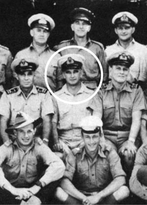 Commander Eric Feldt (circled) and a group of Australian coastwatchers pose in an undated photo. Frank Nash (bottom row, far right) was one of the few American coastwatchers.