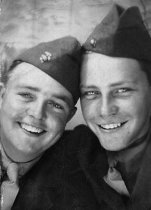 U.S. Marines W.O. Brown (left) and buddy Sid Phillips cram themselves into a photo booth