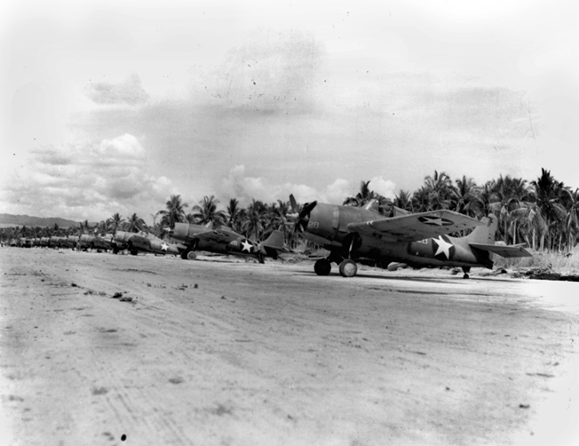 F4F Wildcat planes parked on the fighter strip at Henderson Field. With air superiority, Marines were able to hammer Japanese targets at will.