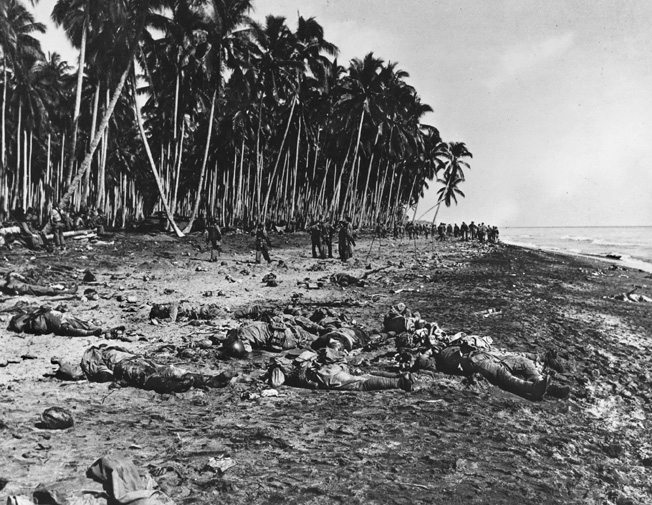 As the battle wound down, some Japanese troops tried to escape by heading into the ocean, but many were cut down as they crossed the beach, and others shot in the surf. This photograph was taken the day after the battle.