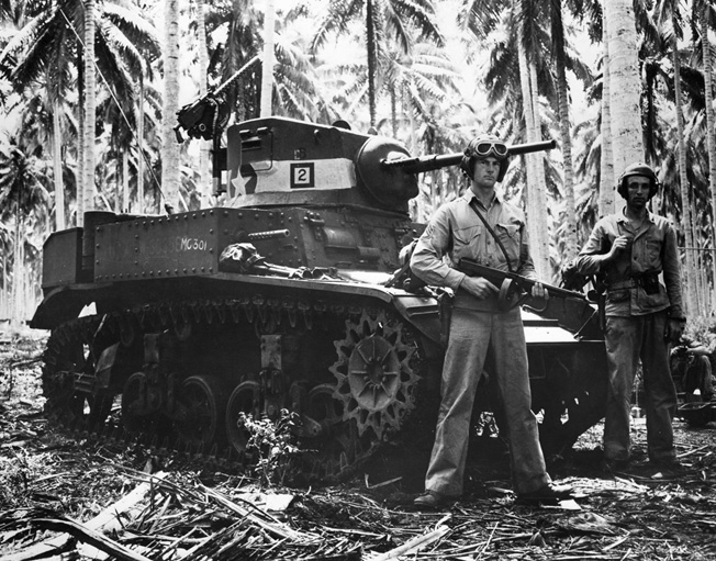 Two tankers pose beside their M5 Stuart light tank used in the Battle of Tenaru, site of one of the Pacific's fiercest battles.