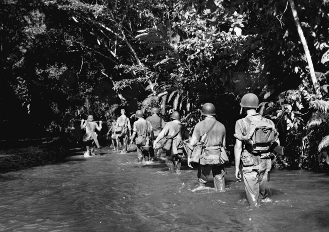 American Marines wade through Alligator Creek, not far from the Tenaru River, on the hunt for the enemy.