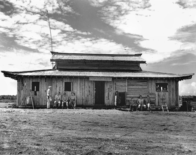"This Japanese-built pagoda next to the airfield at Henderson Field served as headquarters for the ""Cactus Air Force"" throughout the first months of air operations on Guadalcanal."