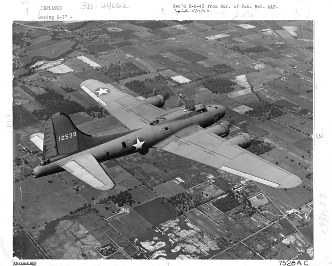Photographed in 1943, this image of a new Boeing B-17 Flying Fortress bomber presents an excellent view of the four-engine aircraft that was instrumental in prosecuting the air war against Nazi Germany. The tail gunner's position is visible at lower left.