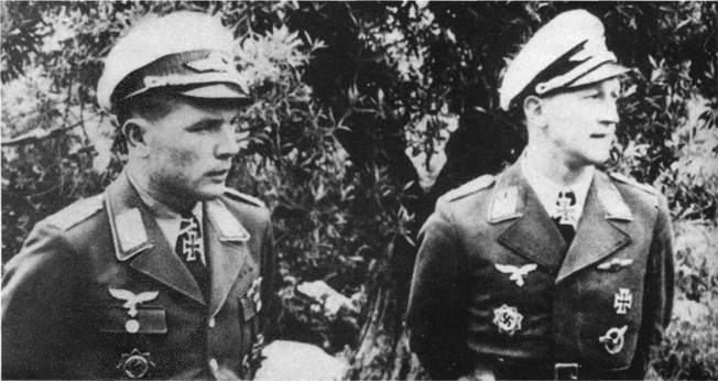Luftwaffe Colonel Gustav Rodel (left) threatened any German pilots who broke off attacks with court-martial.