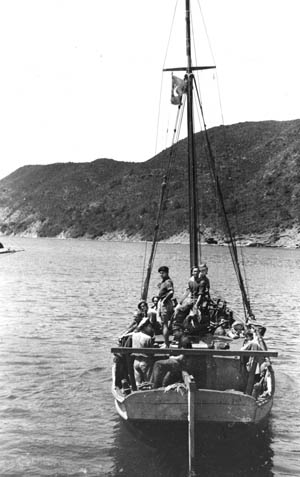 Boat Service men  set out on the dangerous Santerine Raid,  in which they killed 30 enemy soldiers.