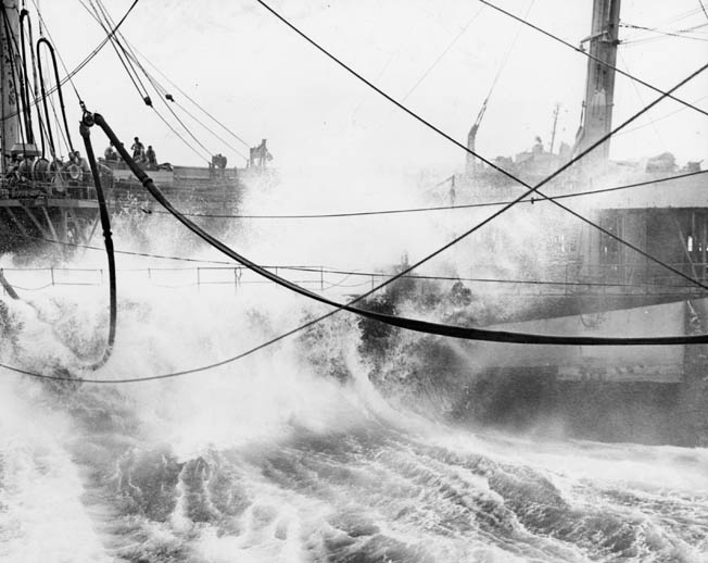 The tanker USS Atascosa attempts to refuel the aircraft carrier USS Lexington during the heavy typhoon known as Cobra in December 1944.