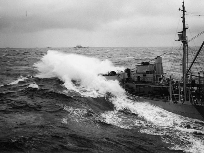 Heavy seas break over the bow of a U.S. Navy fleet oiler during refueling operations as Typhoon Cobra ravaged the U.S. Third Fleet. The oiler was attempting to provide fuel for the aircraft carrier USS Enterprise.
