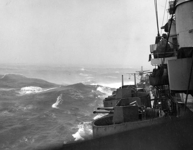 Angry waves and winds buffet the cruiser USS Pittsburgh during Typhoon Connie in June 1945. The Pittsburgh was heavily damaged during the storm, losing more than 100 feet of its bow to the powerful typhoon.