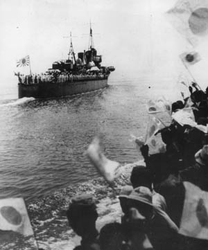 The crew of the Japanese destroyer Hamakaze turns out to greet sailors aboard other vessels of the Imperial Navy during ceremonies in 1941. Along with several other Japanese destroyers, Hamakaze was present during the Battle of Kula Gulf in 1943.