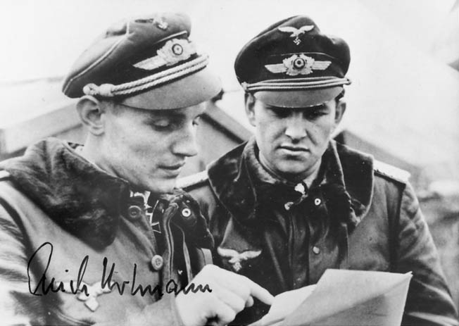 Erich Hartmann, left, confers with fellow JG 52 ace Gerhard Barkhorn. The two men were the only fighter aces to score more than 300 victories in the history of aerial warfare. Between the two of them, they destroyed 653 planes.