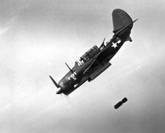 This U.S. Navy Curtiss SB2C Helldiver is releasing its bomb during a training run. Note that both the pilot's and the gunner's canopies are open.