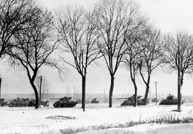 M4 Sherman medium tanks of the 714th Tank Battalion, 12th Armored Division advance warily across the snow-covered landscape toward enemy positions near the town of Bischwiller, France, on January 8, 1945.